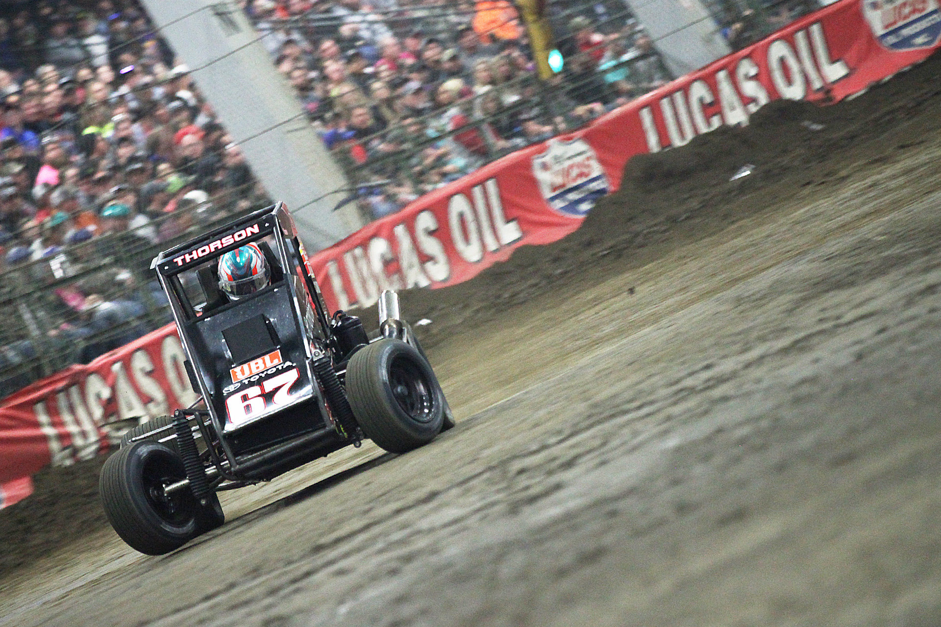 Tanner Thorson on the gas out of turn 2 at the 2016 Chili Bowl Nationals. ( Jeffrey Turford / TDP )