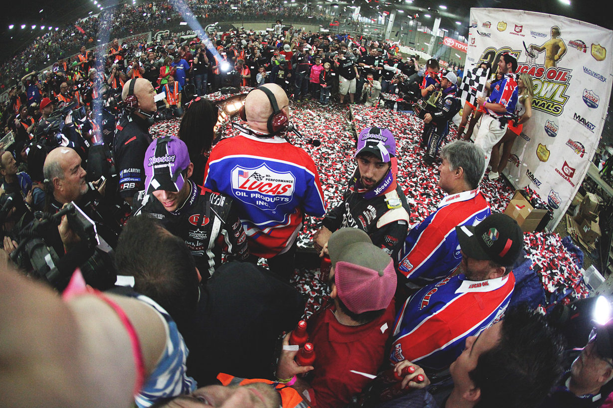The 2016 Chili Bowl victor; Rico Abreu, soaks in the glory while Bryan Clauson and Zach Daum queue up for post-race interviews. ( Jeffrey Turford / TDP )