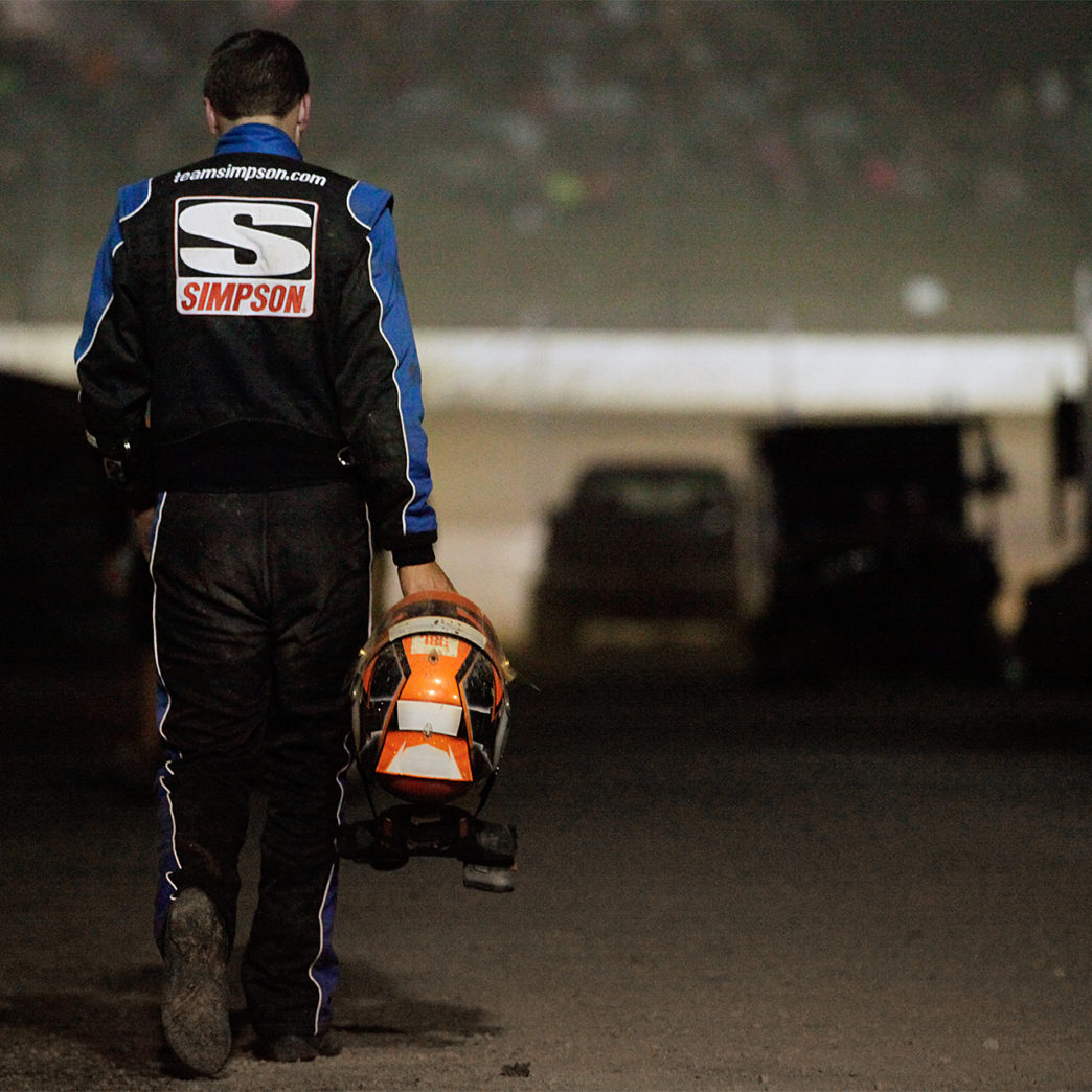 A dejected Christopher Bell walks back to the pits from his wrecked car in the late stages of the 33rd Annual Kings Royal. Bell was running 2nd before he clipped the turn 4 wall. ( Jeffrey Turford / TDP )
