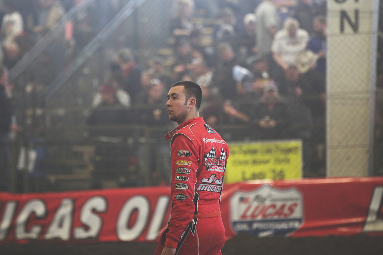 Logan Jarrett surveys the track conditions at The 2016 Chili Bowl. ( Jeffrey Turford / TDP )