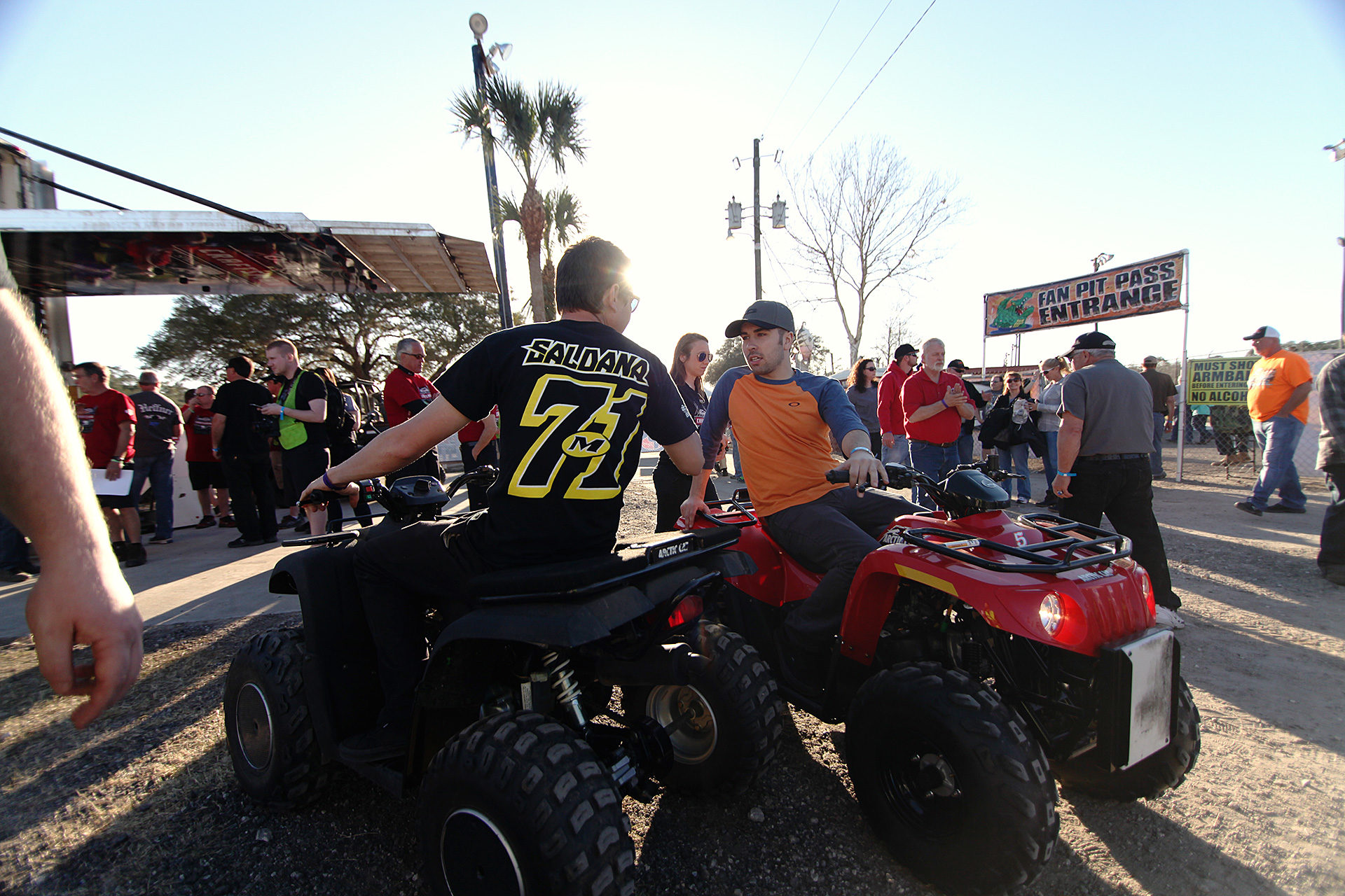R.J. Johnson and David Gravel hang out on their 4-wheelers after the 5pm driver's meeting.( Jeffrey Turford / TDP )