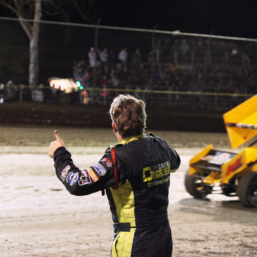 Austin McCarl gets the thumbs-up from father Terry McCarl under yellow at Volusia Speedway.( Jeffrey Turford / TDP )