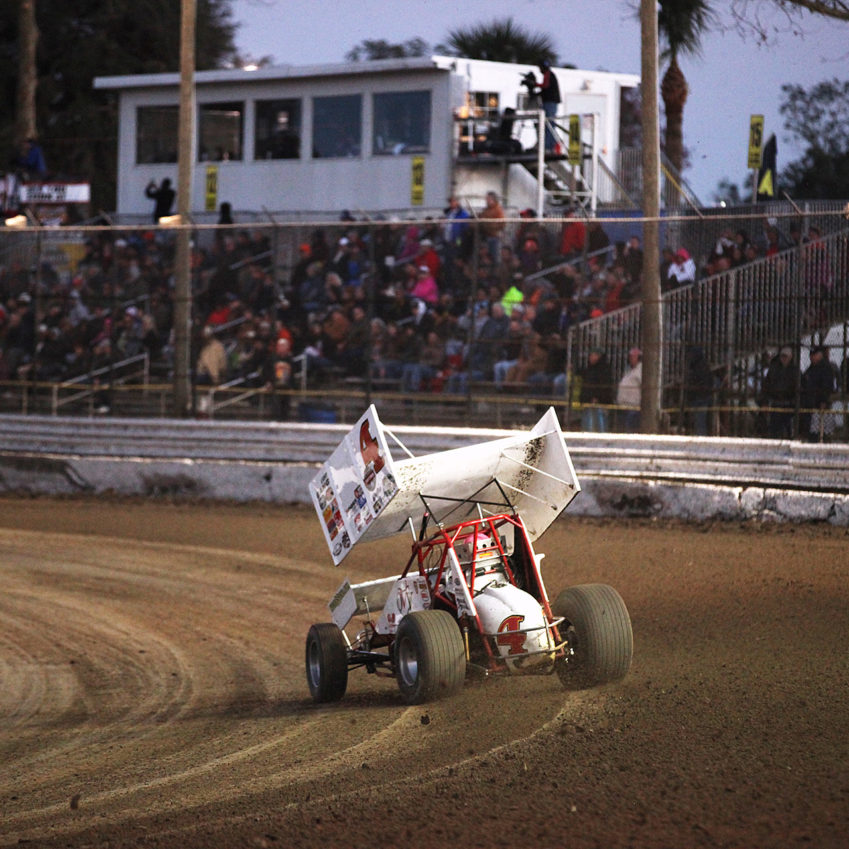 Danny Smith on the gas through turn 4 at Volusia Speedway in Florida.( Jeffrey Turford / TDP )
