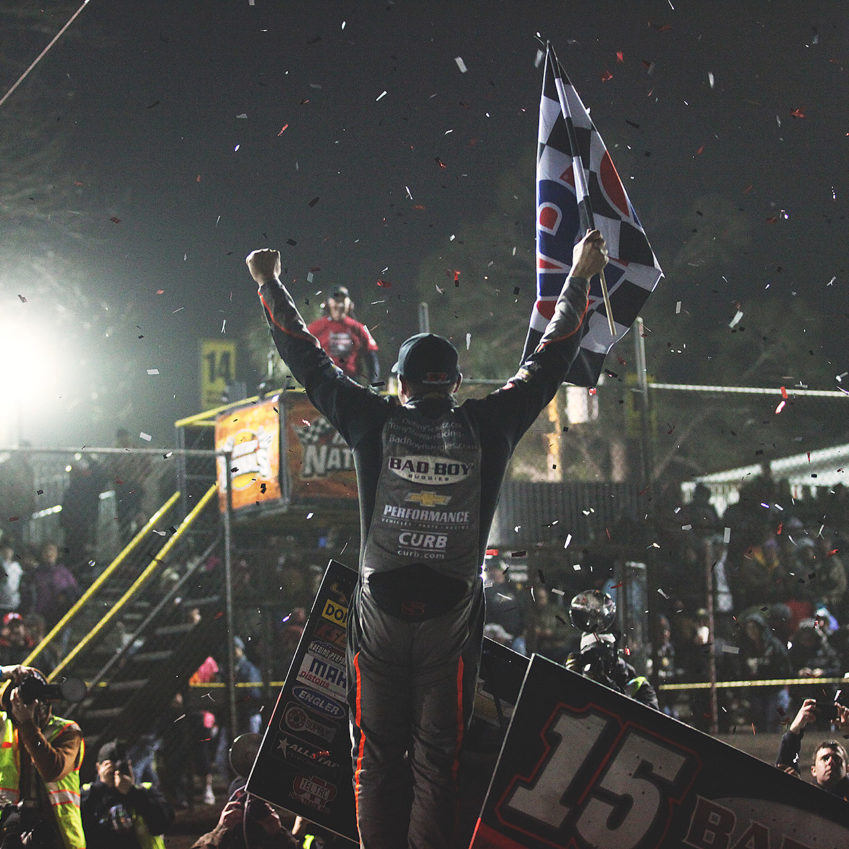Donny Schatz celebrates in victory lane after capturing the Saturday night World of Outlaws series win at Volusia Speedway in Florida, during Sprint Week at The DIRTcar Nationals. ( Jeffrey Turford / TDP )