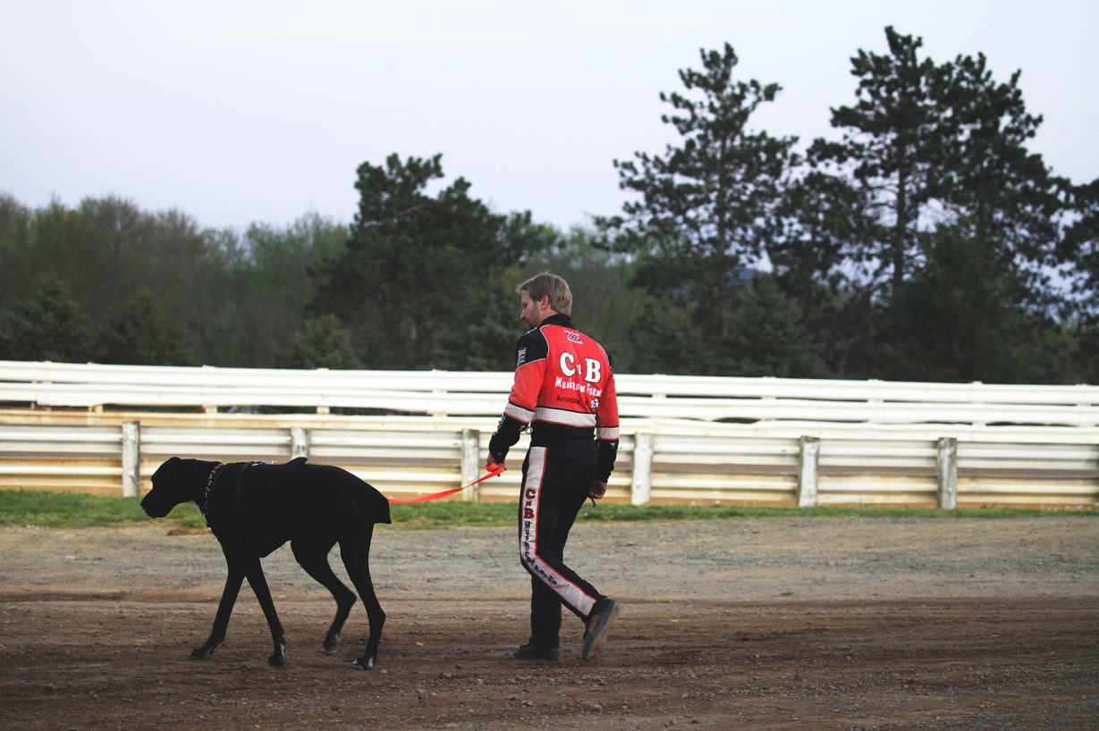 Blane Heimbach walks his dog before the feature race at Selinsgrove Speedway during the Arctic Cat All Stars Circuit event in Pennsylvania–2016. ( Jeffrey Turford / TDP )