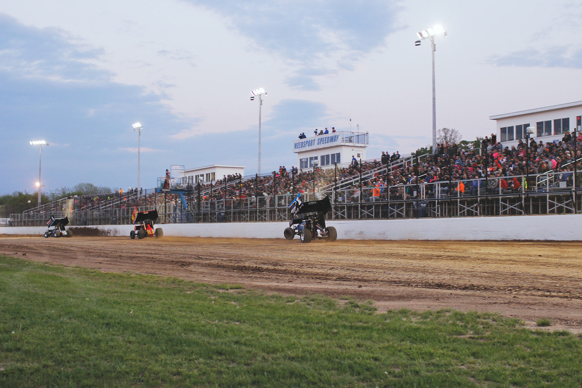 DIRT Modified star Stewart Friesen wheelie's during World of Outlaws heat race action Weedsport Speedway. ( Jeffrey Turford / TDP )