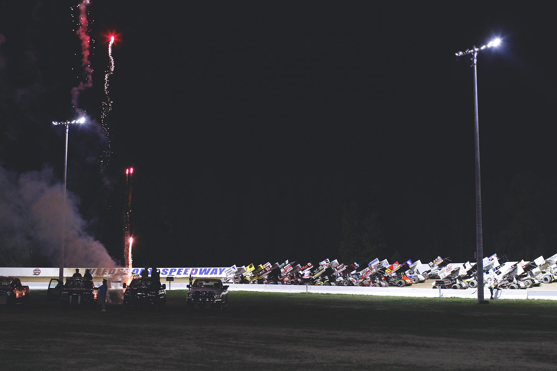 The World of Outlaws 4-wide salute to the fans at Weedsport. ( Jeffrey Turford / TDP )