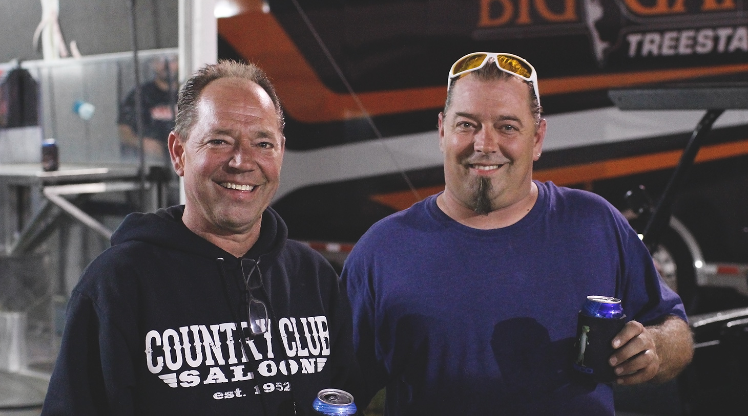 Jason and Paul Sides share a drink after the feature at Weedsport with The World of Outlaws. (Jeffrey Turford / TDP)