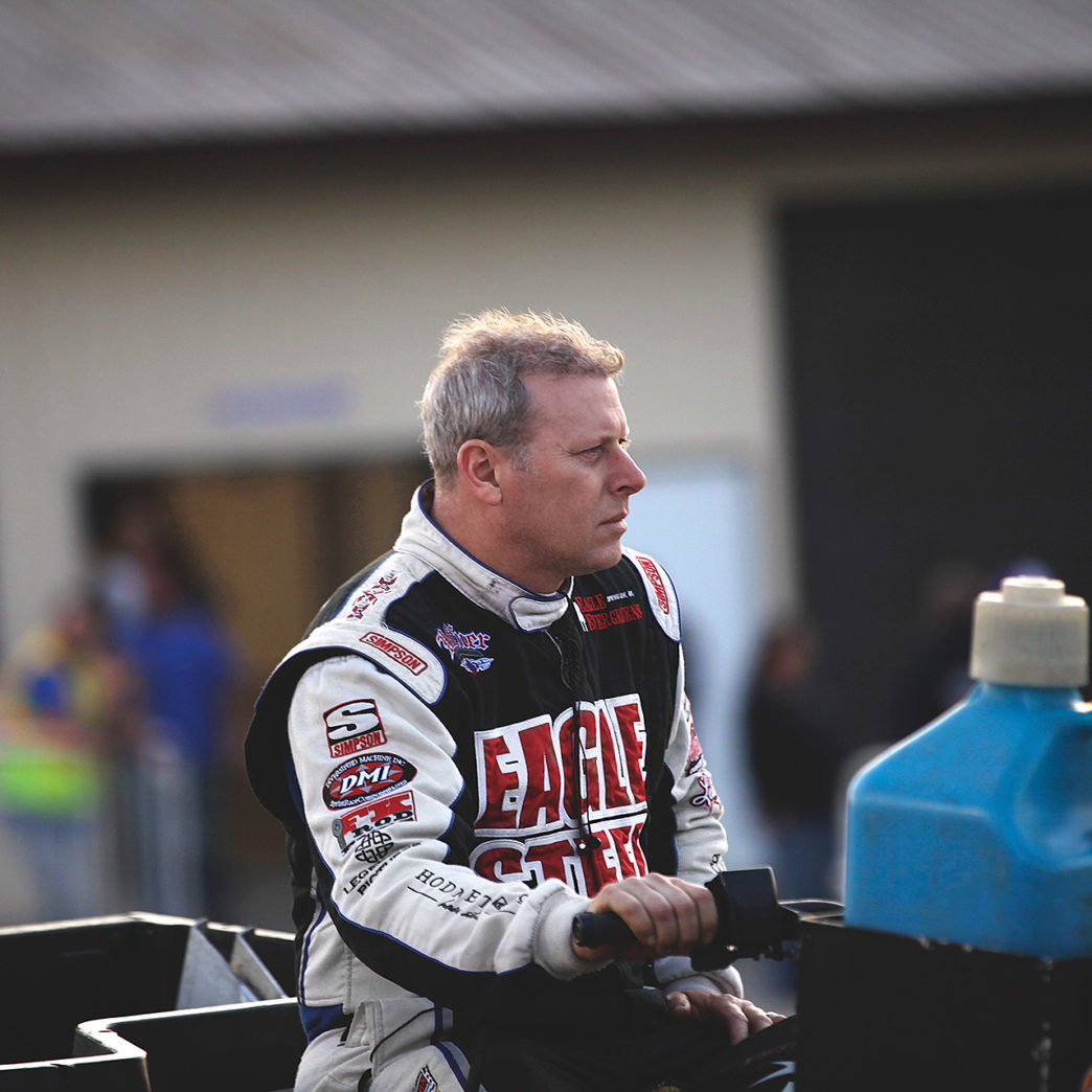 Greg Hodnett checks the track preparation before his heat race at Weedsport Speedway, NY. ( Jeffrey Turford / TDP )