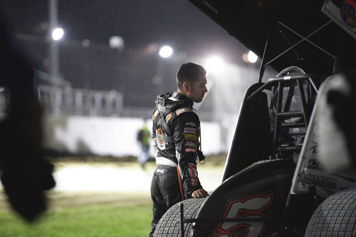 Rain falls as 3rd place finisher David Gravel reflects on a strong World of Outlaws feature race Weedsport Speedway. ( Jeffrey Turford / TDP )