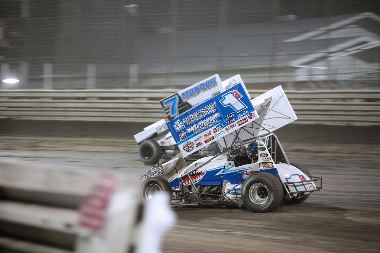 Jacob Allen dives under Paul McMahan during Saturday night's feature event. Jacob Allen and Paul McMahan battling at Knoxville Speedway. McMahan would finish the feature 11th with Jacob Allen placing 13th with The World of Outlaws 410 sprints. ( Jeffrey Turford / TDP )