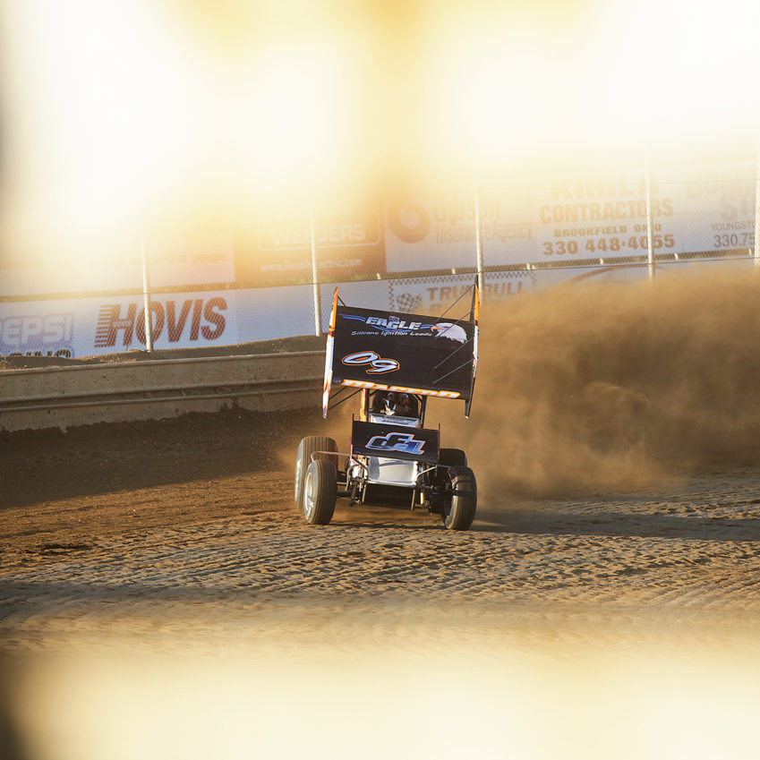 The 09X of Carson Macedo leaves a dirt storm in its wake during qualifying at Sharon Speedway. Macedo qualified 27th of 51 cars at a packed ASCoC event at Sharon Speedway during Ohio Speedweek. ( Jeffrey Turford / TDP )