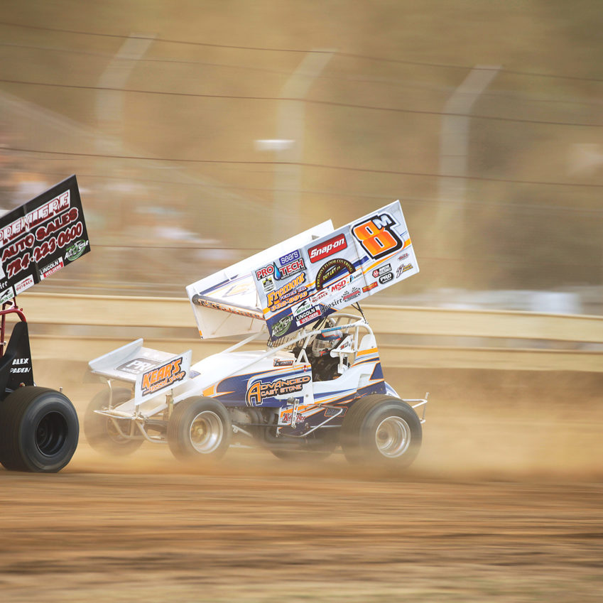 T.J. Michael makes the pass on Alex Paden in the heat race to secure the final transfer spot at Sharon Speedway with The All Star Circuit of Champions. ( Jeffrey Turford / TDP )