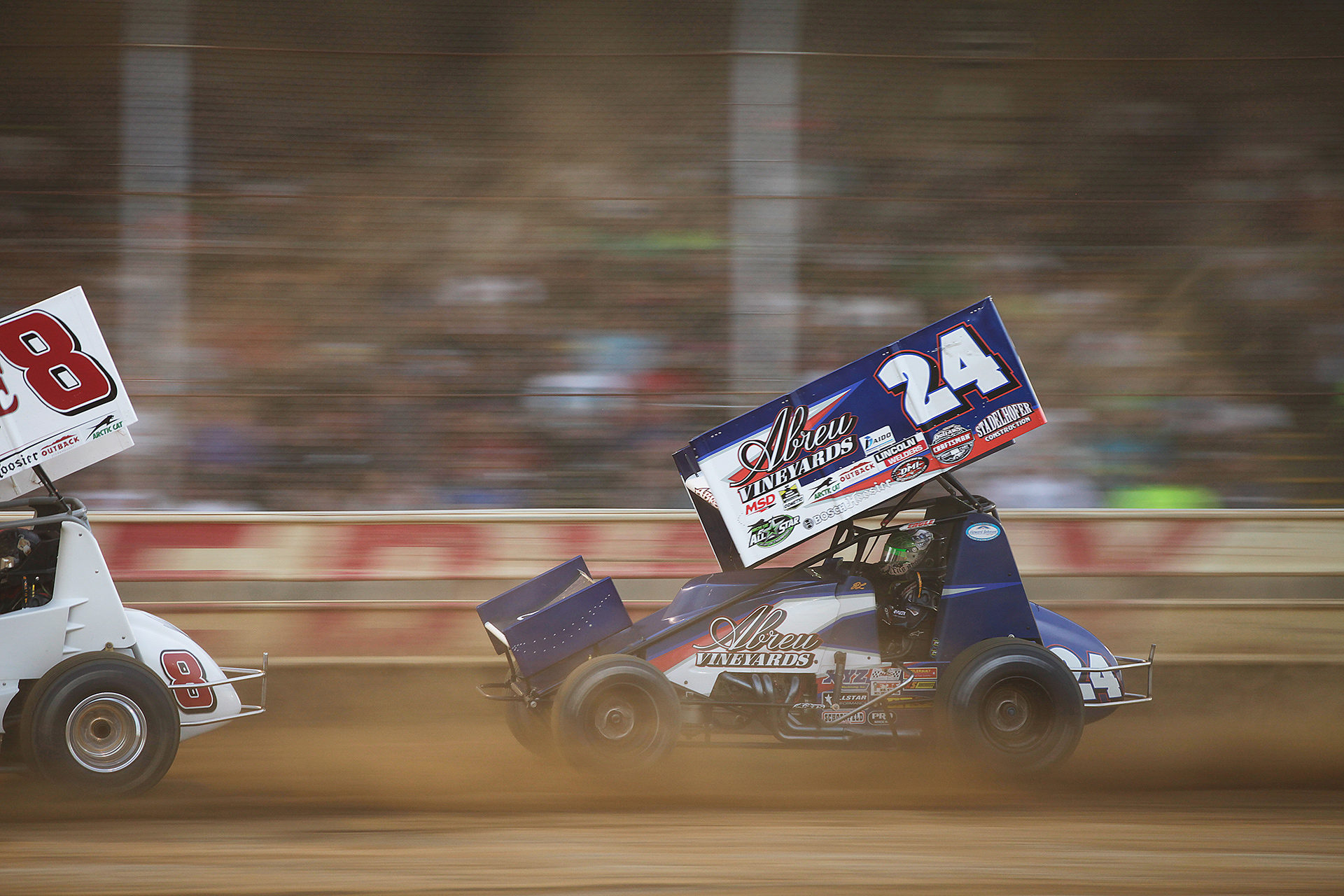 Rico Abreu braves the dust to finish 2nd in his heat and transfer to the A Feature. ( Jeffrey Turford / TDP )