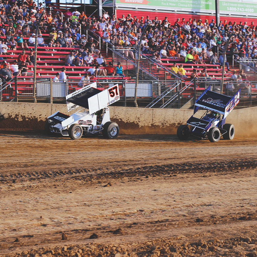 Kyle Larson fights off Rico Abreu in the heat with The World of Outlaws at Lawrenceburg Speedway, IN. ( Jeffrey Turford / TDP )