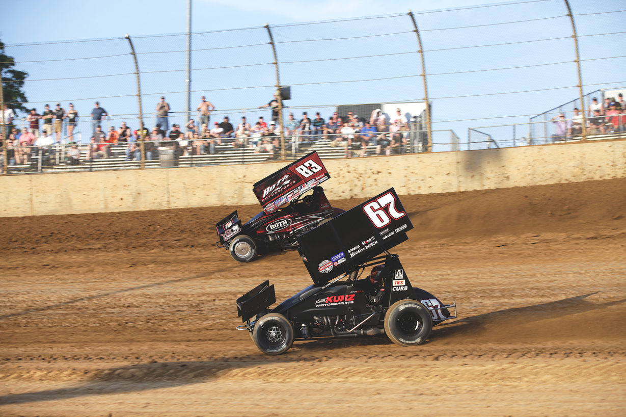 Christopher Bell and Joey Saldana battle it out in the Heat at Lawrenceburg. Saldana would eventually prevail and secure the Heat race win over Christopher Bell at Lawrenceburg Speedway with The World of Outlaws. ( Jeffrey Turford / TDP )