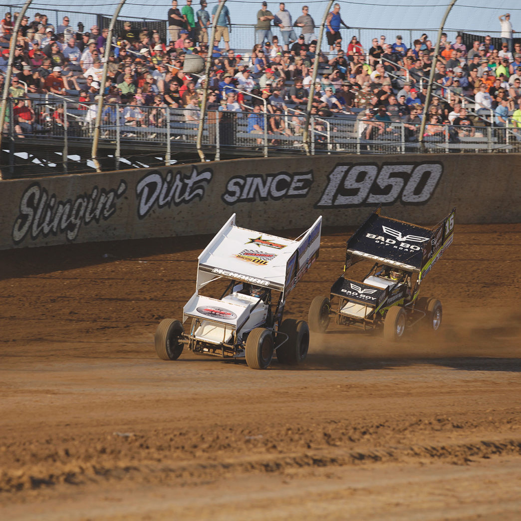 Paul McMahan and Donny Schatz battle for a transfer spot during their heat at Lawrenceburg Speedway. ( Jeffrey Turford / TDP )