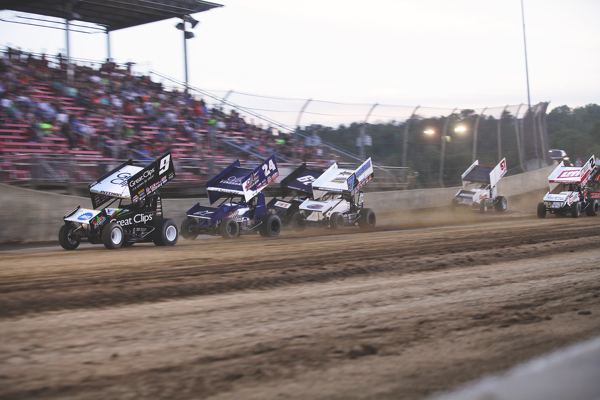 Daryn Pittman leads a stacked field of Rico Abreu, Christopher Bell, Paul McMahan, Kyle Larson, Shane Stewart and David Gravel and Joey Saldana in to the first turn in the dash race at Lawrenceburg Speedway, IN. ( Jeffrey Turford / TDP )