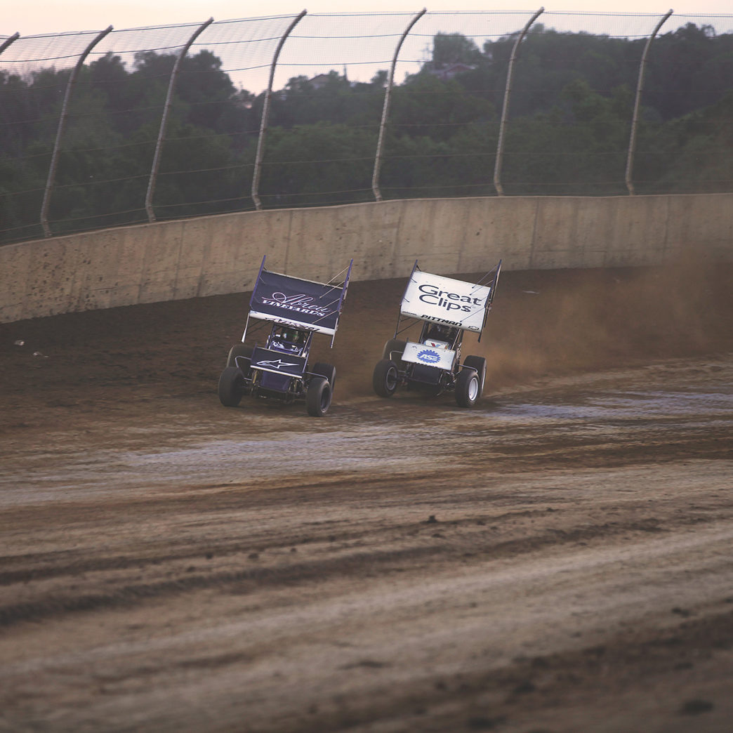 Rico Abreu and Daryn Pittman battle in the Dash at Lawrenceburg. Rico prevailed to earn the pole position in The A Feature. ( Jeffrey Turford / TDP )