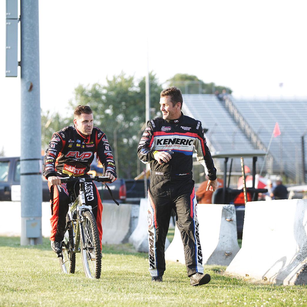 Kerry Madsen and Brian Brown chat on the way back to the pits on Friday at Knoxville Raceway. ( Jeffrey Turford / TDP )