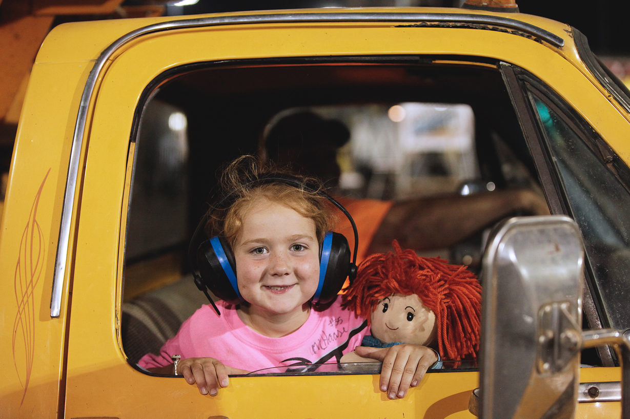 A young McKenna Haase fan sits shotgun in a Knoxville Raceway push truck Friday evening. ( Jeffrey Turford / TDP )