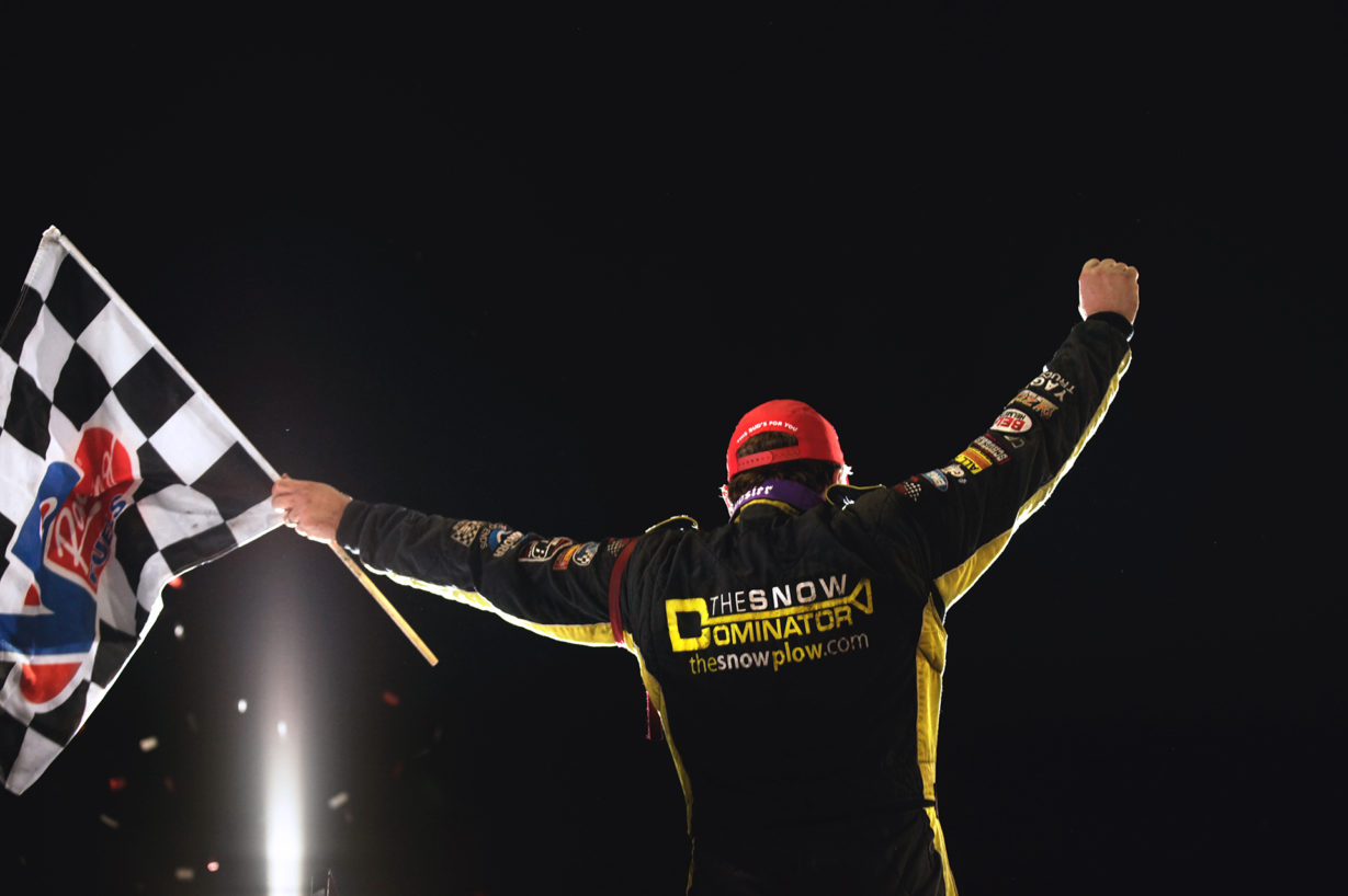 Terry McCarl celebrates his victory on Friday night. McCarl started 1st and finished 1st during the World of Outlaws feature on Friday night at Knoxville Raceway. ( Jeffrey Turford / TDP )