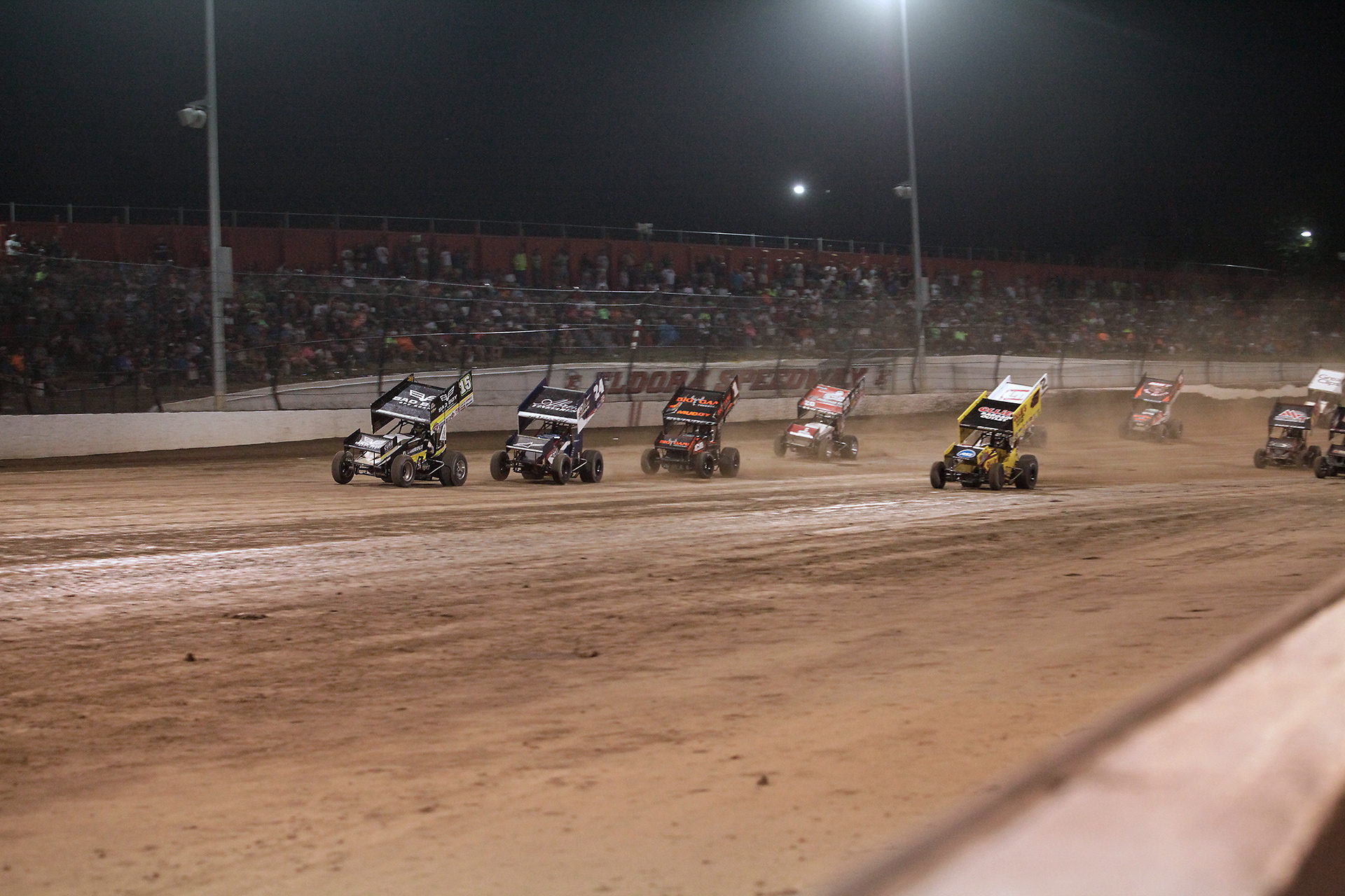 Donny Schatz leading the field into turn 1 at the last restart before the checkered. ( Jeffrey Turford / TDP )