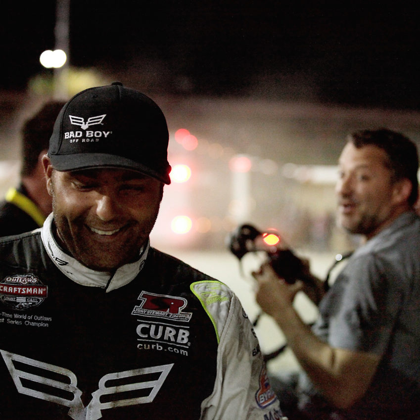 Donny Schatz and Tony Stewart share a laugh in victory lane following the Friday night Feature. ( Jeffrey Turford / TDP )