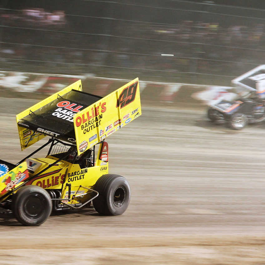 Brad Sweet overtakes Sheldon Haudenschild on the low-side through turn 1. Sweet secured the Hard Charger Award, going from 20th to 12th, the Knight Before The Kings Royal. ( Jeffrey Turford / TDP )