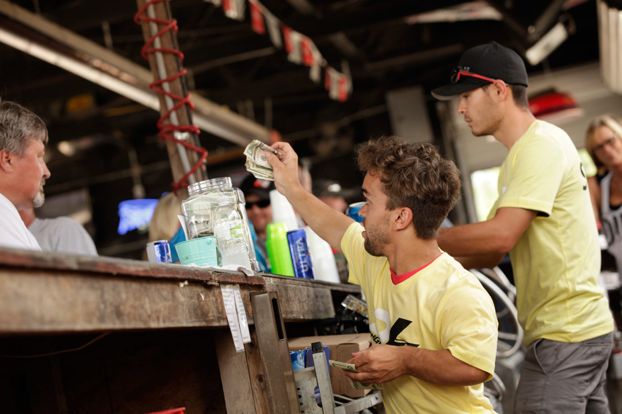 Rico Abreu, Kyle Larson and unpictured, Brad Sweet running the bar at legendary bar, Dingus. Proceeds from the bar going to the family of Bryan Clauson. ( Jeffrey Turford / TDP )