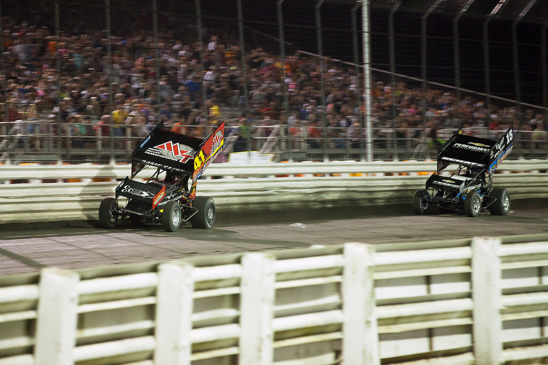 Jason Johnson and Donny Schatz traded the lead multiple times in The Knoxville Nationals A Main. Eventually Johnson would prevail. ( Jeffrey Turford / TDP )