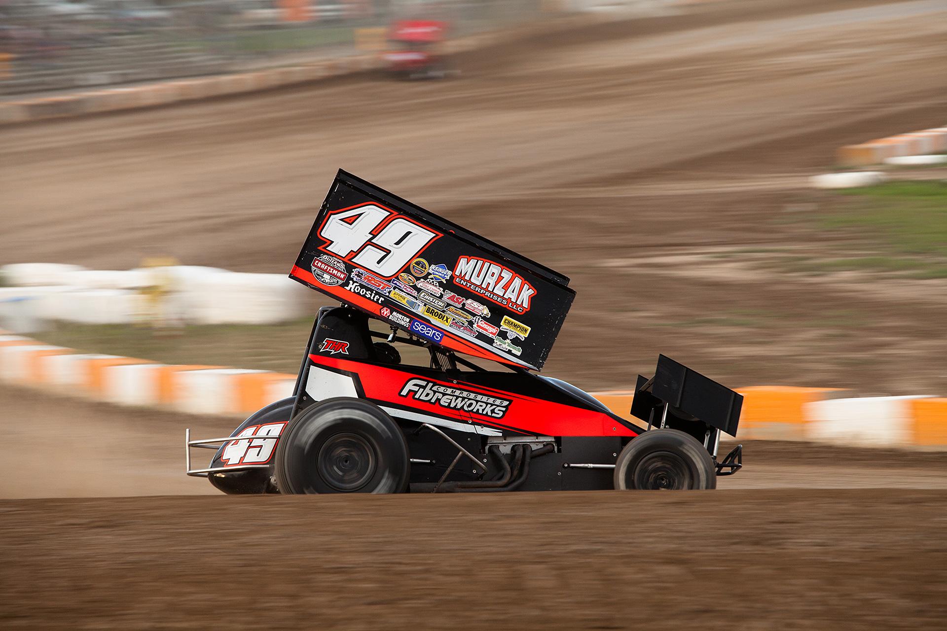 no.49 Scott Kreutter on the gas through turn 4 at Ohsweken Speedway ( Jeffrey Turford / TDP )