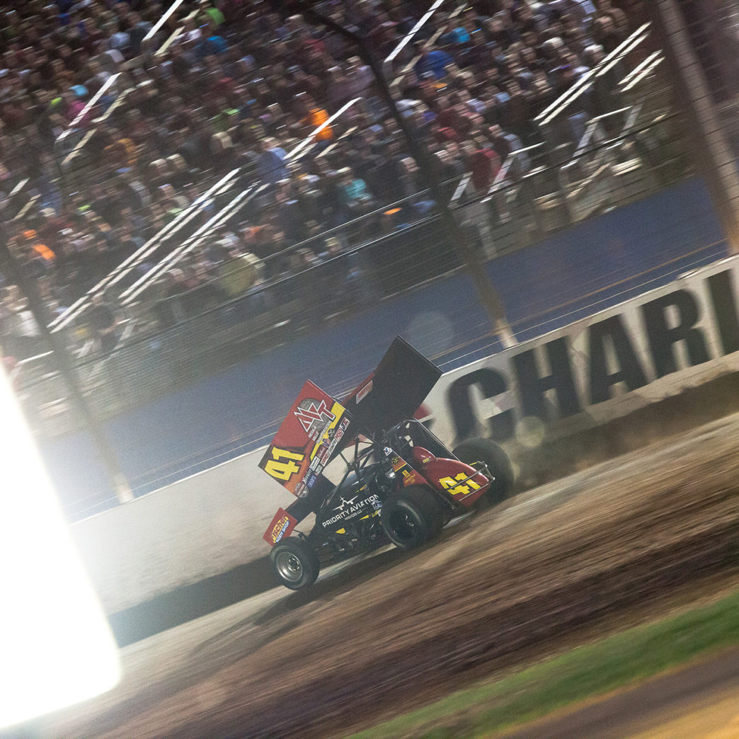 Jason Johnson crosses the finish line to win the Friday night Feature race at The 2016 WoO World Finals in Charlotte, NC. ( Jeffrey Turford / TDP )