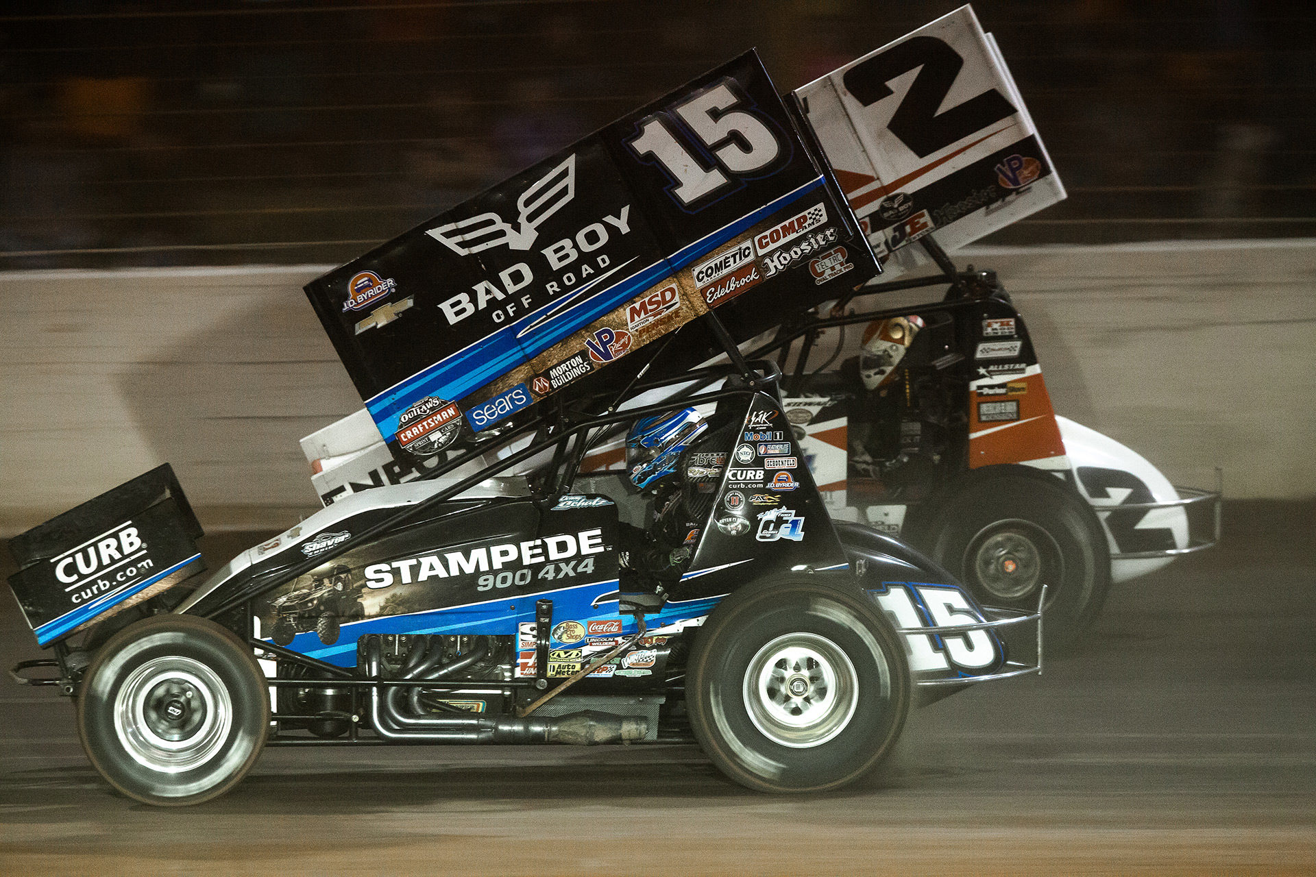 Donny Schatz passing Shane Stewart on the backstretch at The Dirt Track at Charlotte during the WoO World Finals Friday night Feature. Donny Schatz started 15th and made his way to 3rd place, picking up the Hard Charger award during the Friday night Feature at The 2016 WoO World Finals in Charlotte, NC.( Jeffrey Turford / TDP )