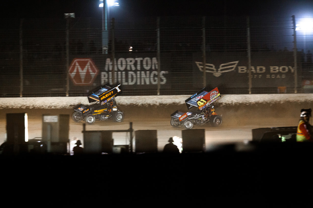 Jason Johnson lines up the race-winning pass on Dale Blaney in the Friday night Feature at The 2016 WoO World Finals in Charlotte, NC. ( Jeffrey Turford / TDP )