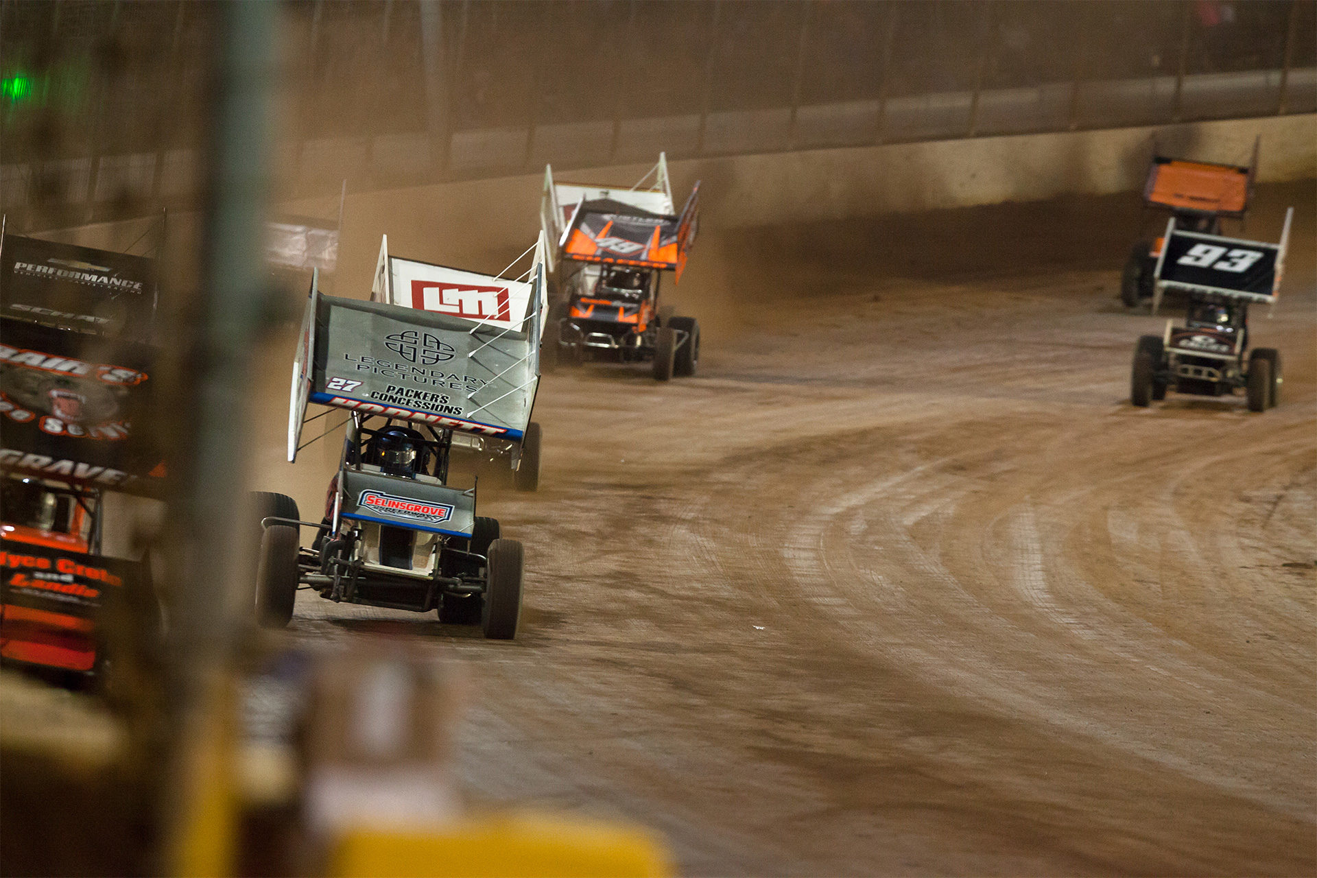 No. 27 Greg Hodnett chases down leader No. 5 David Gravel on the backstretch at The Dirt Track at Charlotte in 2016. ( Jeffrey Turford / TDP )
