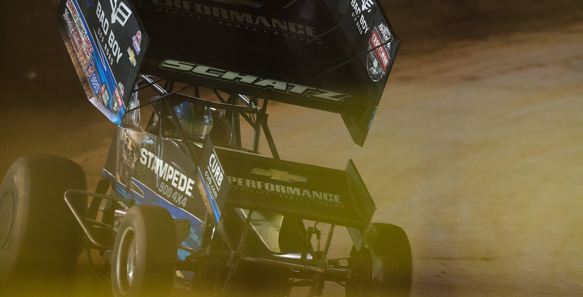 Donny Schatz leading the Feature with 5 laps to go at The 2016 WoO World Finals in Charlotte, N. Schatz passed David Gravel for the lead on lap 15 and never looked back on his way to his 25th Feature win with The World of Outlaws. ( Jeffrey Turford / TDP )