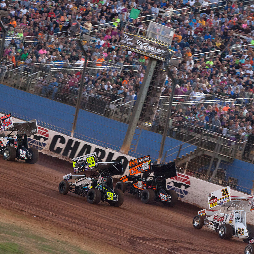 Greg Hodnett leads the 8 car Heat 1 field on the final day of the 2016 World of Outlaws World Finals in Charlotte, NC. ( Jeffrey Turford / TDP )