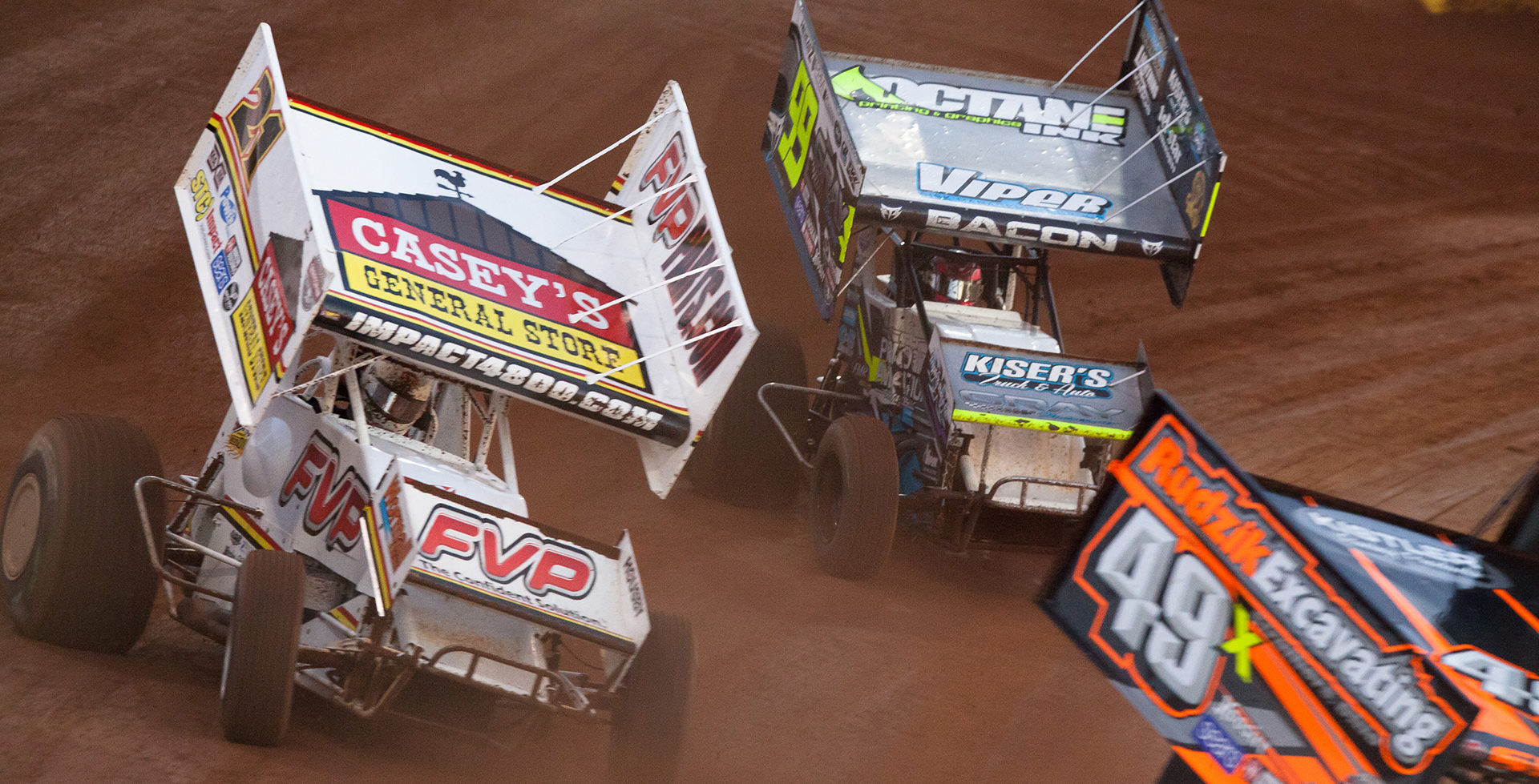 No. 21 Brian Brown, 99 Brady Bacon and the 49x of Tim Shaffer battle for the final transfer spot in Heat 1 at WoO World Finals in 2016. ( Jeffrey Turford / TDP )