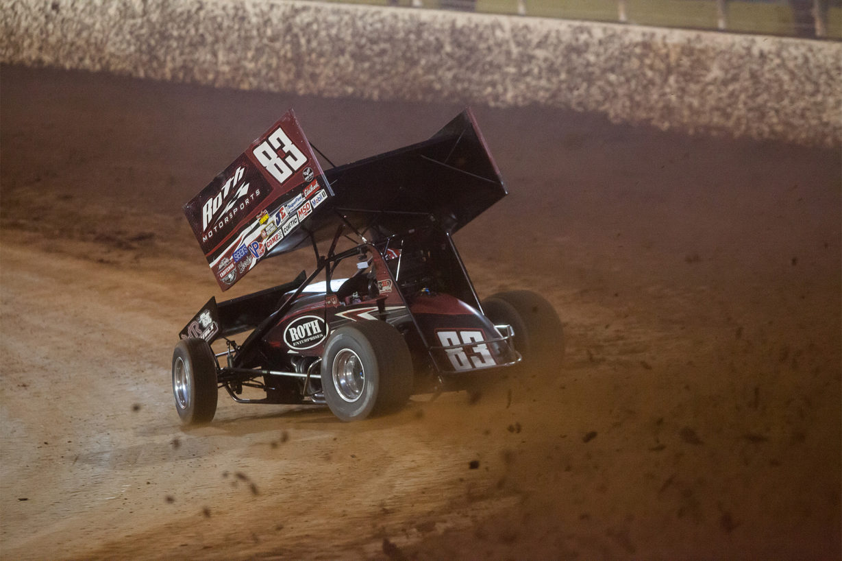 No. 83 Joey Saldana on the gas through turns 3 and 4 in Heat 2 on the final night of the 2016 WoO World Finals at The Dirt Track at Charlotte. Saldana placed 2nd in his heat to collect a transfer spot to the Feature at The 2016 World of Outlaws World Finals in North Carolina. ( Jeffrey Turford / TDP )
