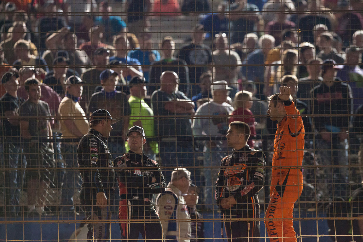 Donny Schatz, Shane Stewart, David Gravel and Ian Madsen relax during track prep, knowing they have all transferred to the Feature race on Saturday night for The Bad Boy Off Road World of Outlaws World Finals at The Dirt Track at Charlotte in 2016. ( Jeffrey Turford / TDP )