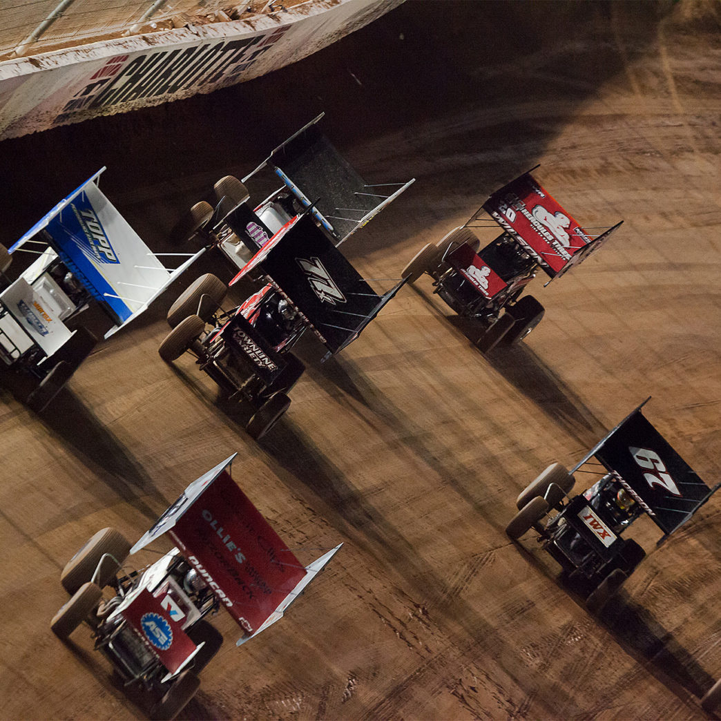 Cole Duncan leads a field of 15 cars in the 10 Lap C Feature to claim 1 of 2 B main transfer spots. The No. 4 of Cole Duncan and the 23C of Tyler Courtney placed 1st and 2nd in the C-Main to collect transfers spots to the B-feature at the 2016 World of Outlaws World Finals.( Jeffrey Turford / TDP )