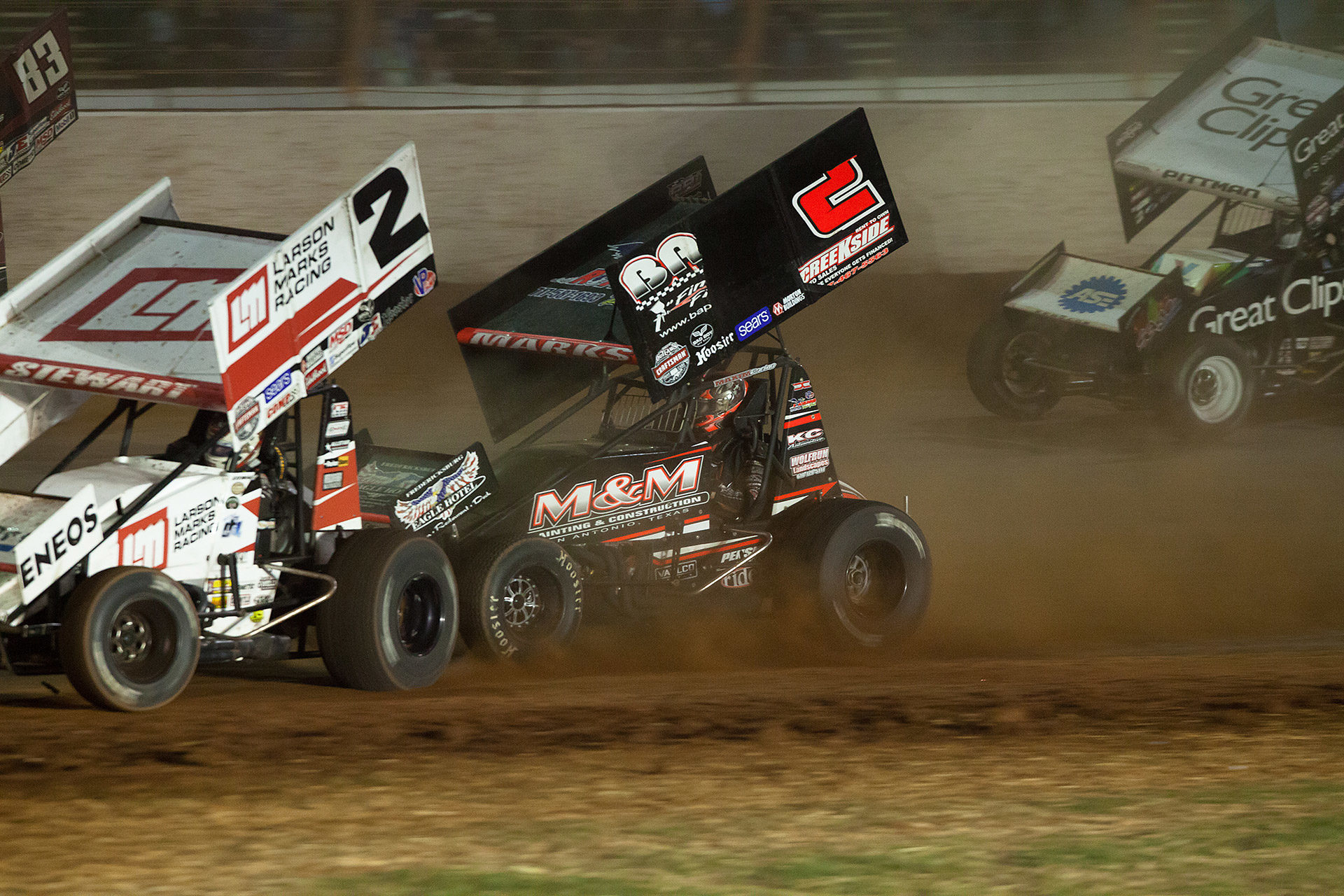 No. 2m Brent Marks and Larson Marks racer; Shane Stewart, duel in the feature race on night 2 of The World Of Outlaws World Finals in Charlotte, NC. (Jeffrey Turford / TDP)