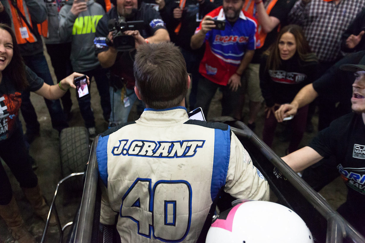 Friday January 13, 2017 TULSA, Oklahoma - Friday January 13, 2017 TULSA, Oklahoma - No. 39bc, Justin Grant shares his victory with wife and twin newborns, over a cellphone on Vacuworx Qualifying Night, of The 31st annual Lucas Oil Chili Bowl Nationals presented by General Tire ( Jeffrey Turford / TDP )