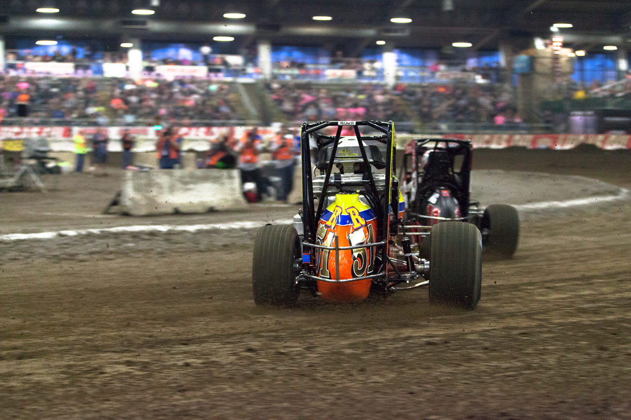 Friday January 13, 2017 TULSA, Oklahoma - No. 51R Brody Roa on the hammer into turn 3, battling Dave Darland for passing points in qualifier Race 2 at The 2017 Chili Bowl Nationals ( Jeffrey Turford / TDP )