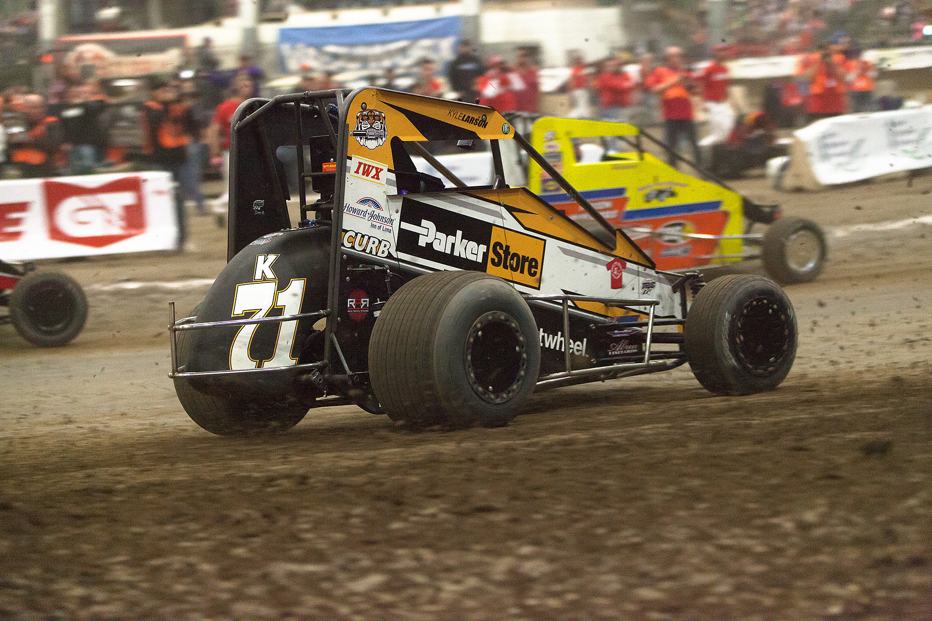 Saturday January 14, TULSA, Oklahoma - Kyle Larson battling hard into turn 1 of the D-Feature, on the final night of The 31st annual Lucas Oil Chili Bowl Nationals ( Jeffrey Turford / TDP )
