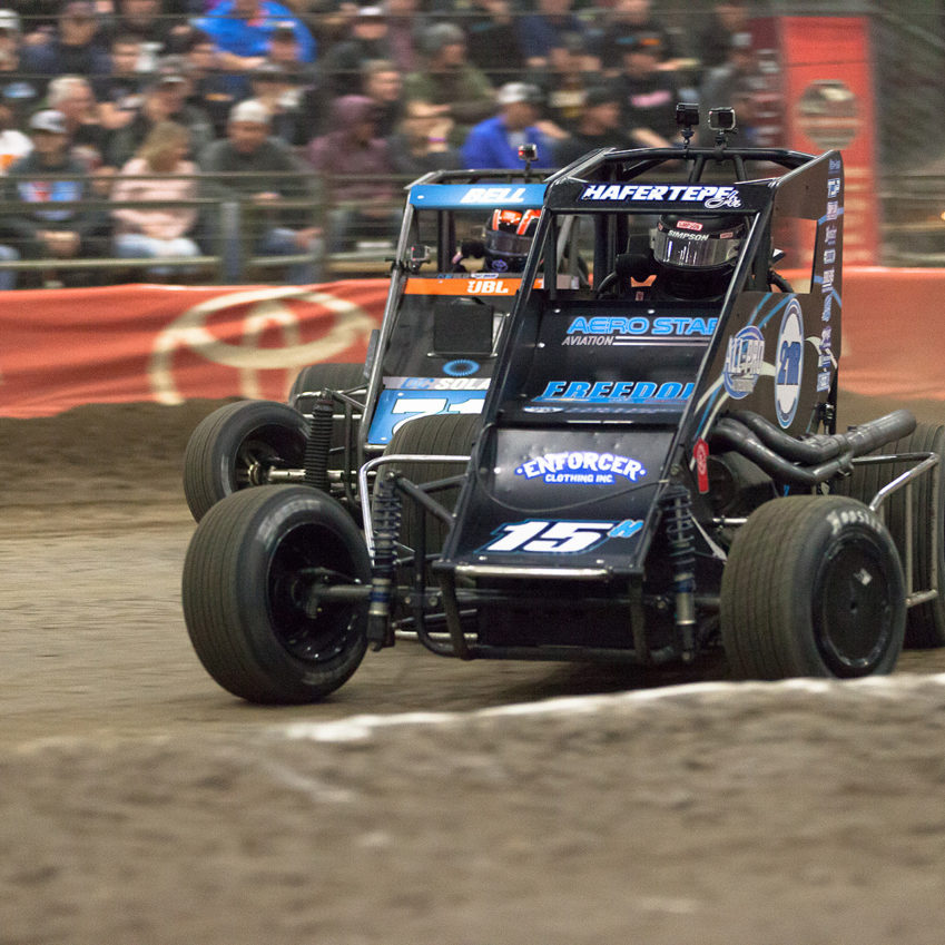 Thursday January 12, 2017 TULSA, Oklahoma - 15H Sam Hafertepe Jr. leading Christopher Bell into turn 3 of the A-Feature on J.C.T. Qualifying Night of The 31st annual Lucas Oil Chili Bowl Nationals presented by General Tire ( Jeffrey Turford / TDP )