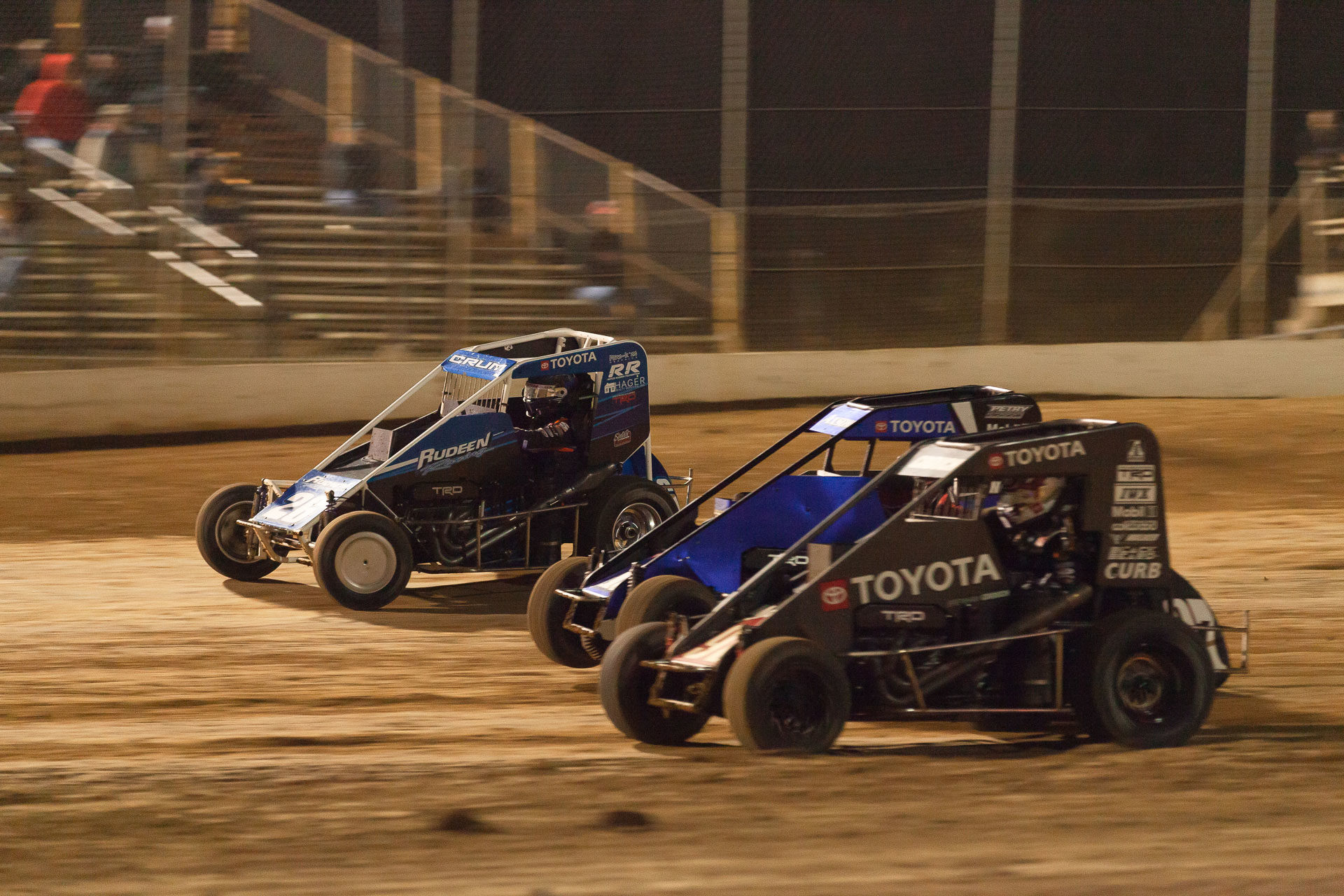 Brenham Crouch in the 97 gets speed out of turn 4 to overtake Chance Crum and no. 15 Emerson Axsom. Brenham Crouch would go on to win the A Feature at the 2021 Lake Ozark Speedway Memorial Weekend Sprint and Midget Nationals. ( Jeffrey Turford / TDP )