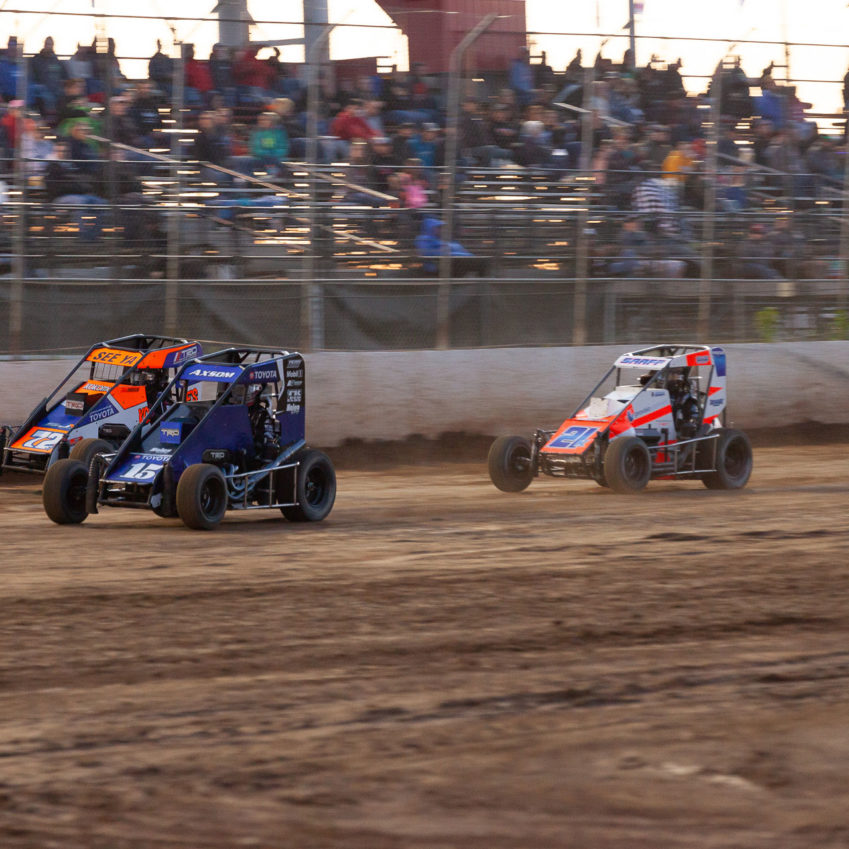 No 15 Emerson Axsom is chased by 72 Sam Johnson and 21K Karter Sarff for 2nd during the heat races on night 1 of the Lake Ozark Speedway Memorial Weekend Sprint and Midget Nationals. ( Jeffrey Turford / TDP )