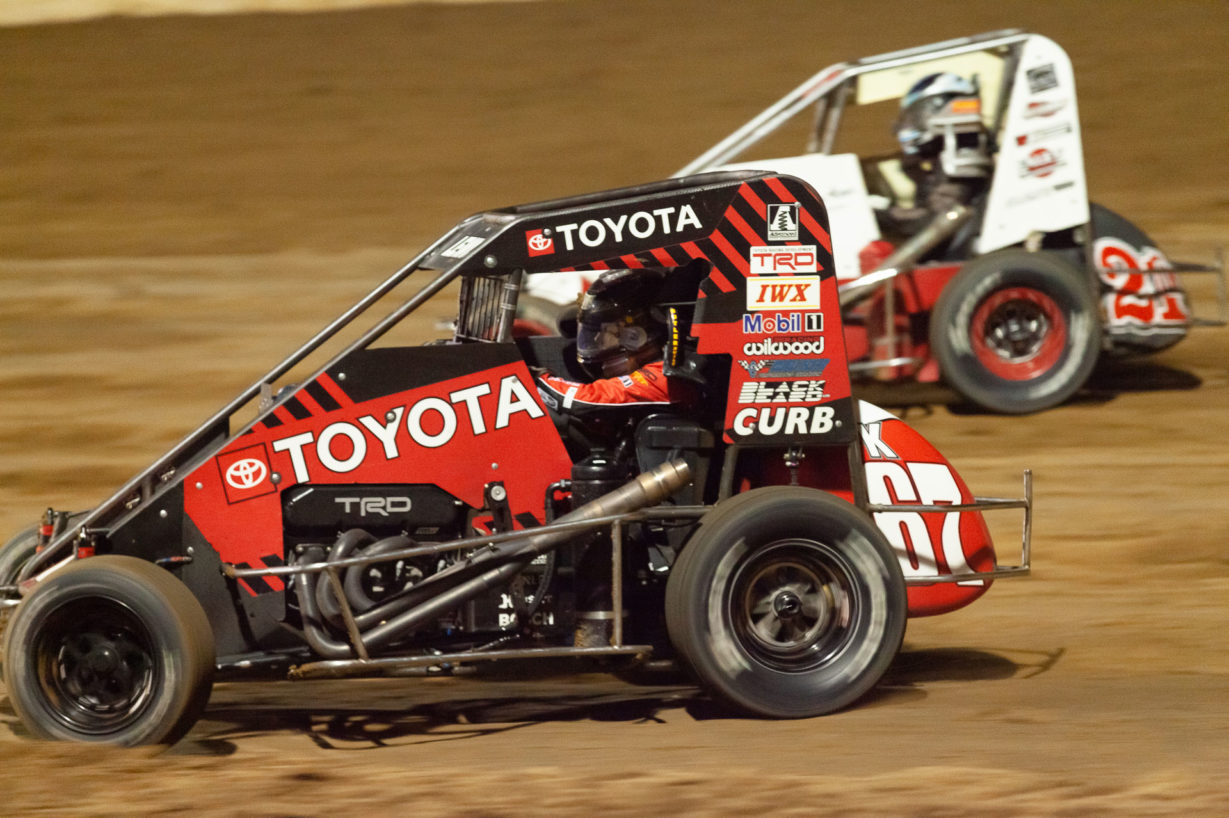 No.67K Cade Lewis sneaks under the 21K of Karter Sarff at Lake Ozark Speedway during the Saturday night Feature. ( Jeffrey Turford / TDP )